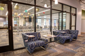 photo: common area with easy chairs and couch at the CMC Morgridge Commons